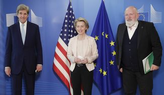 In this March 9, 2021, file photo, United States Special Presidential Envoy for Climate John Kerry, left, European Commission President Ursula von der Leyen, center, and European Commissioner for European Green Deal Frans Timmermans pose for photographers prior to a meeting at EU headquarters in Brussels. The European Union reached a tentative climate deal on Wednesday, April 21, 2021, that should make the 27-nation bloc climate-neutral by 2050, with member states and parliament agreeing on the targets on the eve of a virtual summit that U.S. President Biden will host. (Olivier Hoslet, Pool via AP, File)