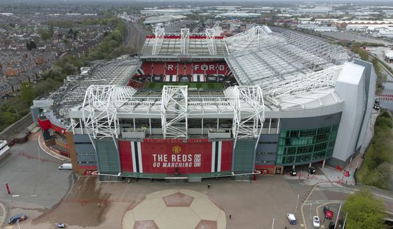 Manchester United's Old Trafford Stadium is seen after the collapse of English involvement in the proposed European Super League, Manchester, England, Wednesday, April 21, 2021. Manchester United executive vice-chairman Ed Woodward will step down from his role at the end of 2021 an announcement which came before Manchester United, along with the other five Premier League sides involved in the proposed European Super League (ESL), withdrew from the competition. (AP Photo/Jon Super) **FILE**
