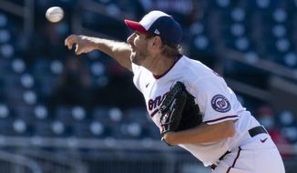 Washington Nationals starting pitcher Max Scherzer (31), throws during the third inning of a baseball game against the St. Louis Cardinals in Washington, Wednesday, April 21, 2021. (AP Photo/Manuel Balce Ceneta)