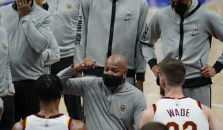 Cleveland Cavaliers head coach J.B. Bickerstaff talks to his team during the first half of an NBA basketball game against the Detroit Pistons, Monday, April 19, 2021, in Detroit. (AP Photo/Carlos Osorio)