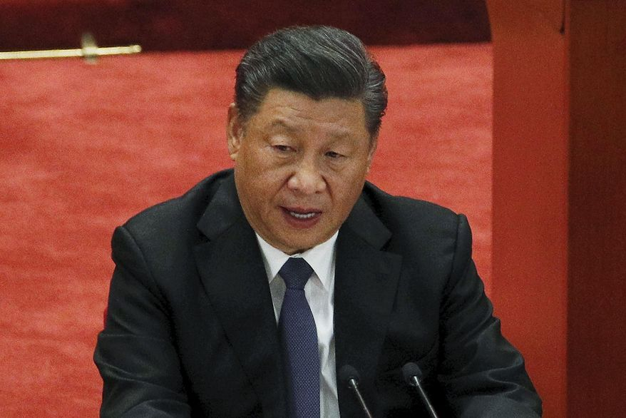 In this Oct. 23, 2020, file photo, Chinese President Xi Jinping delivers his speech at the commemorating conference on the 70th anniversary of the Chinese army entering North Korea to resist the U.S. Army at the Great Hall of the People in Beijing. (AP Photo/Andy Wong, File)