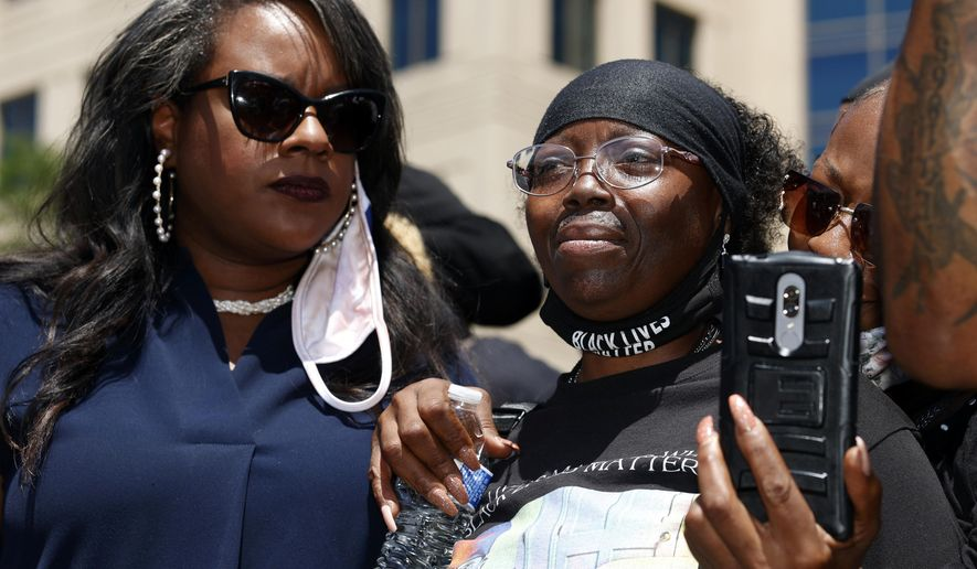 FILE - In this June 27, 2020, file photo, state Rep. Leslie Herod, D-Denver, left, holds Sheneen McClain during a rally and march over the death of McClain's son, 23-year-old Elijah, outside the police department in Aurora, Colo. McClain died in late August 2019 after he was stopped while walking to his apartment by three Aurora Police Department officers. A day after a former Minneapolis police officer was convicted in the killing of George Floyd, Colorado lawmakers considered legislation Wednesday, April 21, 2021, to tighten standards set by a sweeping police accountability law adopted last year following protests over Floyd's murder.  (AP Photo/David Zalubowski, File)