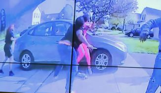 In an image from police bodycam video that the Columbus Police Department played during a news conference Tuesday night, April 20, 2021, a teenage girl, foreground, appears to wield a knife during an altercation before being shot by a police officer Tuesday, April 20, 2021, in Columbus, Ohio. Police shot and the girl just as the verdict was being announced in the trial for the killing of George Floyd. State law allows police to use deadly force to protect themselves or others, and investigators will determine whether this shooting was such an instance, Interim Police Chief Michael Woods said at the news conference. (Columbus Police Department via WSYX-TV via AP)