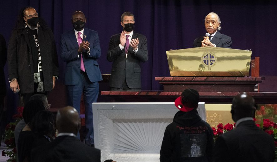 The Rev. Al Sharpton, right, speaks over the casket of Daunte Wright, alongside attorneys Antonio Romanucci, center, and Ben Crump, center left, and the Rev. Greg Drumwright, left, Wednesday, April 21, 2021, in Minneapolis. The 20-year-old Wright was killed by former Brooklyn Center police Officer Kim Potter during a traffic stop. (AP Photo/Julio Cortez)