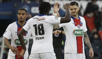 PSG's Mauro Icardi, right, celebrates with PSG's Moise Kean after scoring his side's fifth goal during the French Cup quarter final soccer match between Paris Saint-Germain and Angers SCO at the Parc des Princes stadium in Paris, France, Wednesday, April 21, 2021. (AP Photo/Lewis Joly)