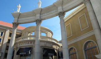 This Oct. 1, 2020 photo shows the exterior of Caesars casino in Atlantic City, N.J.  Caesars Entertainment, the casino's parent company, announced Wednesday, April 21, 2021, a $170 million renovation of hotel rooms and suites at Harrah's and Caesars casinos. (AP Photo/Wayne Parry)