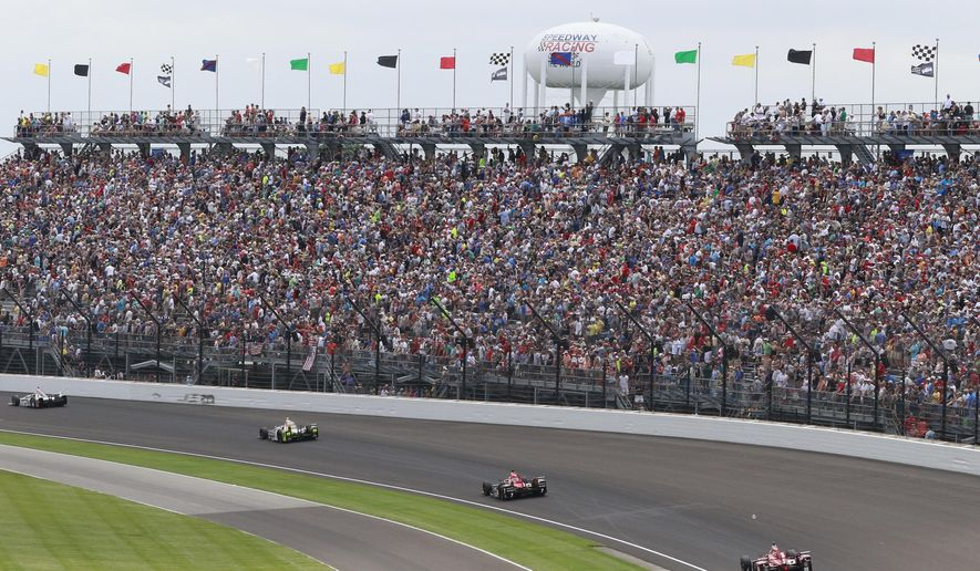 """Fans watch the running of the Indianapolis 500 auto race in the first turn at Indianapolis Motor Speedway in Indianapolis, in this Sunday, May 28, 2017, file photo. The Indianapolis 500 will be the largest sporting event since the start of the pandemic with 135,000 spectators permitted to attend """"The Greatest Spectacle in Racing"""" next month.  Indianapolis Motor Speedway said Wednesday, April 21, 2021, it worked with the Marion County Public Health Department to determine 40% of venue capacity can attend the May 30 race.  (AP Photo/R Brent Smith, File) **FILE**"""