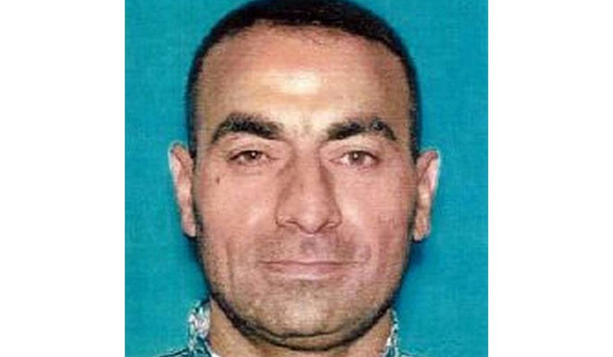 In this undated photo released by FBI Sacramento shows Omar Abdulsattar Ameen.  A federal judge in California refused Wednesday, April 21, 2021, to allow the extradition to Iraq of Ameen, accused of killing for the Islamic State, saying cellphone evidence shows he was in Turkey at the time of the slaying. The U.S. Justice Department has tried since 2018 to return Omar Abdulsattar Ameen to Iraq under a treaty with that nation. (FBI Sacramento via AP)