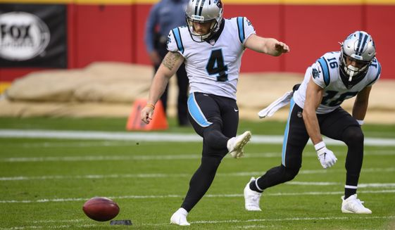 In this  Sunday, Nov. 8, 2020 file photo, Carolina Panthers kicker Joey Slye (4) attempts an onside kick with the Kansas City Chiefs recovered during the second half of an NFL football game in Kansas City, Mo. NFL owners approved eliminating overtime in preseason games and expanded selection of jersey numbers for receivers, running backs and defensive backs. The owners did approve establishing a maximum number of players in the setup zone (between 10 and 25 yards from the kickoff) in hopes of enhancing onside kick opportunities. Defending teams will be limited to nine players in that zone, Wednesday, April 21, 2021.(AP Photo/Reed Hoffmann, File) **FILE**