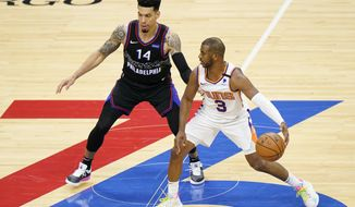 Phoenix Suns' Chris Paul, right, tries to dribble past Philadelphia 76ers' Danny Green during the first half of an NBA basketball game, Wednesday, April 21, 2021, in Philadelphia. (AP Photo/Matt Slocum)