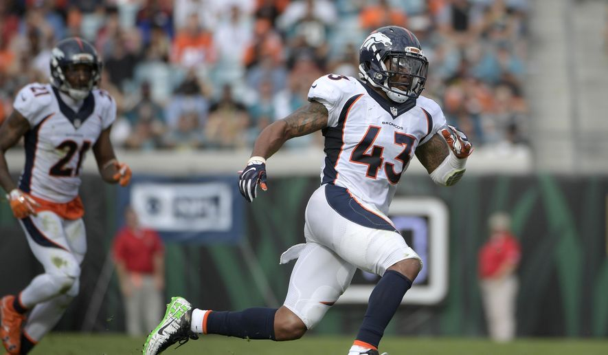 """In this Sunday, Dec. 4, 2016, photo, Denver Broncos strong safety T.J. Ward (43) follows a play during the first half of an NFL football game against the Jacksonville Jaguars in Jacksonville, Fla. T.J. Ward, one of the members of the Denver Broncos' famed """"No Fly Zone"""" secondary, announced his retirement from the NFL on Wednesday, April 21, 2021. Ward helped the Broncos win Super Bowl 50. Ward played eight seasons in the NFL with Cleveland, Denver and Tampa Bay. He last played in 2017 for the Buccaneers. (AP Photo/Phelan M. Ebenhack) **FILE**"""