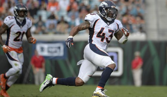 """FILE - In this  Sunday, Dec. 4, 2016 file photo, Denver Broncos strong safety T.J. Ward (43) follows a play during the first half of an NFL football game against the Jacksonville Jaguars in Jacksonville, Fla. T.J. Ward, one of the members of the Denver Broncos' famed """"No Fly Zone"""" secondary, announced his retirement from the NFL on Wednesday, April 21, 2021. Ward helped the Broncos win Super Bowl 50. Ward played eight seasons in the NFL with Cleveland, Denver and Tampa Bay. He last played in 2017 for the Buccaneers.(AP Photo/Phelan M. Ebenhack, File)"""