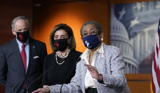 In this April 21, 2021, photo, Del. Eleanor Holmes-Norton, D-D.C., center, joined from left by Sen. Tom Carper, D-Del., and House Speaker Nancy Pelosi, D-Calif., speaks at a news conference ahead of the House vote on H.R. 51- the Washington, D.C. Admission Act, on Capitol Hill in Washington (AP Photo/J. Scott Applewhite)