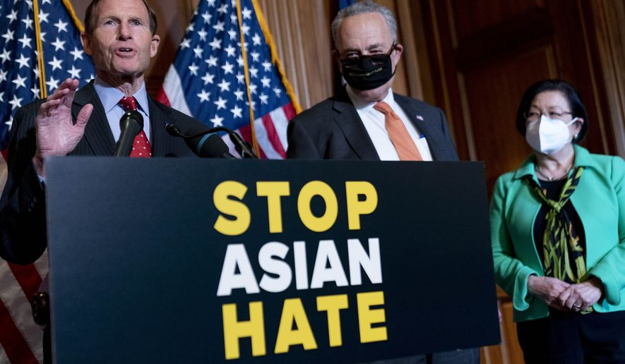 Sen. Richard Blumenthal, D-Conn., left, accompanied by Senate Majority Leader Chuck Schumer of N.Y., and Sen. Mazie Hirono, D-Hawaii, speaks at a news conference after the Senate passes a COVID-19 Hate Crimes Act on Capitol Hill, Thursday, April 22, 2021, in Washington. (AP Photo/Andrew Harnik)