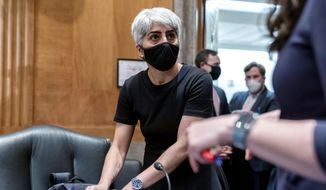 Kiran Ahuja, the nominee to be Office of Personnel Management Director, appears before a Senate Governmental Affairs Committee hybrid nominations hearing on Capitol Hill, Thursday, April 22, 2021, in Washington. (AP Photo/Andrew Harnik) **FILE**