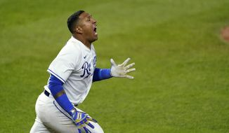 Kansas City Royals' Salvador Perez celebrates after hitting a single to drive in the winning run during the ninth inning of the team's baseball game against the Tampa Bay Rays on Wednesday, April 21, 2021, in Kansas City, Mo. The Royals won 9-8. (AP Photo/Charlie Riedel)