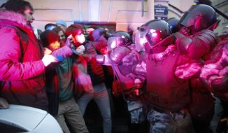 People clash with police during a protest in support of jailed opposition leader Alexei Navalny in St. Petersburg, Russia, Wednesday, April 21, 2021. A human rights group that monitors political repressions said at least 400 people were arrested across the country in connection with the protests. Many were seized before protests even began, including two top Navalny associates in Moscow. (AP Photo/Dmitri Lovetsky)