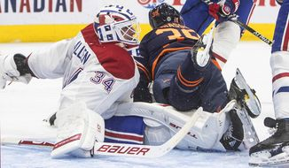 Edmonton Oilers' Alex Chiasson (39) crashes into Montreal Canadiens' goalie Jake Allen (34) during the second period of an NHL hockey game, Wednesday, April 21, 2021 in Edmonton, Alberta. (Jason Franson/The Canadian  Press via AP)