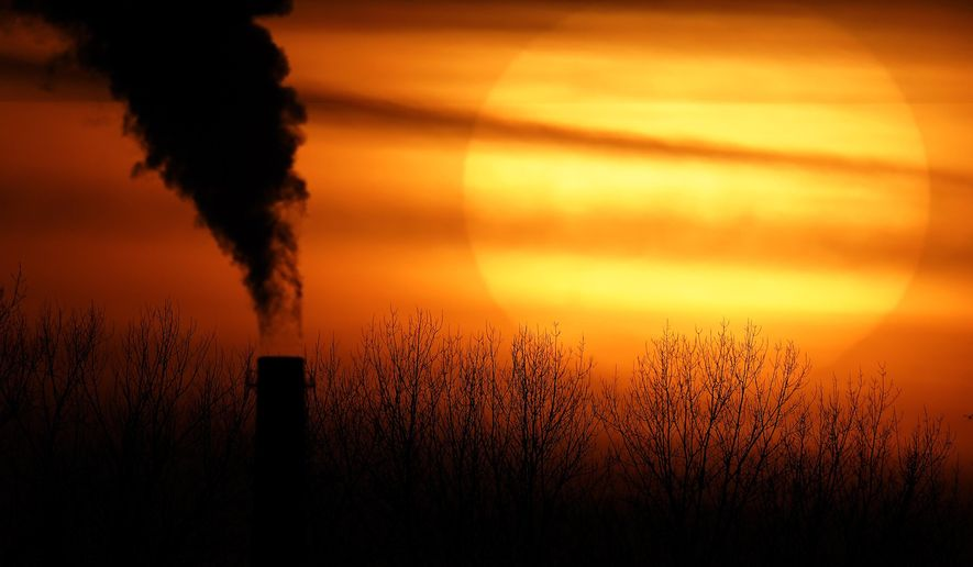 FILE - In this Feb. 1, 2021 file photo, emissions from a coal-fired power plant are silhouetted against the setting sun in Independence, Mo. President Joe Biden is convening a coalition of the willing, the unwilling, the desperate-for-help and the avid-for-money for a two-day summit aimed at rallying the world's worst polluters to do more to slow climate change. Biden's first task when his virtual summit opens Thursday is to convince the world that the United States is both willing and able isn't just willing to meet an ambitious new emissions-cutting pledge, but also able.  (AP Photo/Charlie Riedel, File)