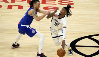 Memphis Grizzlies guard Ja Morant (12) is defended by Los Angeles Clippers guard Amir Coffey during the first half of an NBA basketball game Wednesday, April 21, 2021, in Los Angeles. (AP Photo/Marcio Jose Sanchez)