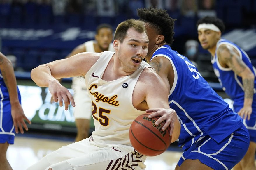 FILE - Loyola of Chicago center Cameron Krutwig drives to the basket during the first half of an NCAA college basketball game against Drake in Des Moines, Iowa, in this Sunday, Feb. 14, 2021, file photo. Krutwig, who helped Loyola Chicago reach a Final Four as a freshman and return to the Sweet 16 as a senior this year, has decided to turn pro and forgo his final year of eligibility. Krutwig announced his decision Thursday, April 22, 2021, in a YouTube video, saying it was time to move on. (AP Photo/Charlie Neibergall, File)