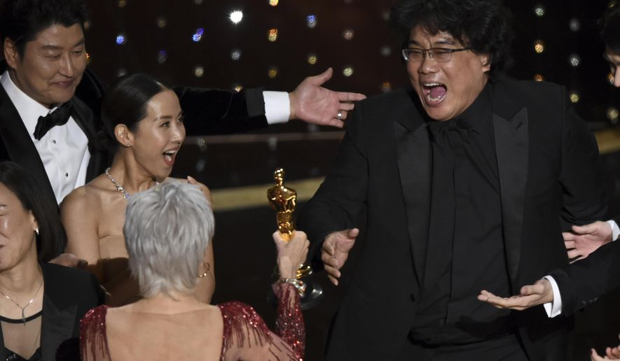 """FILE - Bong Joon Ho, right, reacts as he is presented with the award for best picture for """"Parasite"""" from presenter Jane Fonda at the Oscars on Sunday, Feb. 9, 2020, at the Dolby Theatre in Los Angeles. Looking on from left are Kang-Ho Song and Kwak Sin Ae. (AP Photo/Chris Pizzello)"""