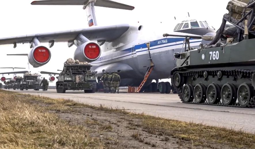 This photo released on Thursday, April 22, 2021, by Russian Defense Ministry Press Service, shows Russian military vehicles preparing for loading into a plane for airborne drills during maneuvers in Crimea. (Russian Defense Ministry Press Service via AP) ** FILE **