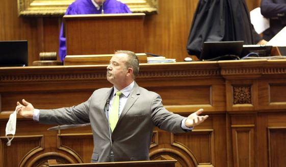 South Carolina Sen. Stephen Goldfinch, R-Murrells Inlet, shows fellow lawmakers he shaved off his beard on Thursday, April 22, 2021, in Columbia, S.C. Goldfinch offered to shave if senators could reach a compromise on a bill about state-owned utility Santee Cooper. (AP Photo/Jeffrey Collins)