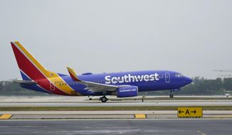 A Southwest Airlines Boeing 737 passenger plane takes off from Fort Lauderdale-Hollywood International Airport, Tuesday, April 20, 2021, in Fort Lauderdale, Fla. Southwest Airlines Co. on Thursday, April 22 reported first-quarter net income of $116 million, after reporting a loss in the same period a year earlier.  The Dallas-based company said it had profit of 19 cents per share. (AP Photo/Wilfredo Lee)