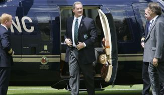 """FILE - In this file photo dated Wednesday June 11, 2008, Allen Stanford, chairman of Stanford 20/20 Cricket, and the England and Wales Cricket Board (ECB), gets out of his helicopter on landing at Lords Cricket Ground, in London. Stanford brought razzmatazz to the quaint sport by signing a deal with the England and Wales Cricket Board in 2008 for a dollars 20 million series of Twenty20 matches against a Caribbean team labeled the """"Stanford All-Stars."""" but it lasted one series and Stanford was charged with fraud and sentenced to 110 years in prison in 2012. (AP Photo/Lefteris Pitarakis, FILE)"""