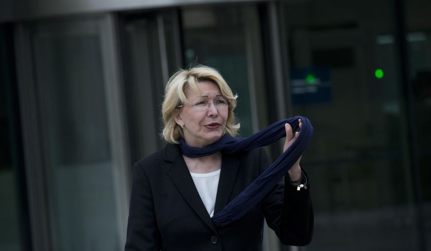 FILE - In this Nov. 16, 2017 file photo, Ousted Venezuelan prosecutor general Luisa Ortega leaves the International Criminal Court after presenting evidence denouncing President Maduro for crimes against humanity in The Hague, Netherlands. The former Venezuelan attorney general who defied President Nicolas Maduro by siding with his opponents has been implicated in a major corruption case involving a Venezuelan businessman who this week pleaded guilty to paying $1 million in bribes, two people familiar with the case said Thursday, April 22, 2021. (AP Photo/Peter Dejong, File)
