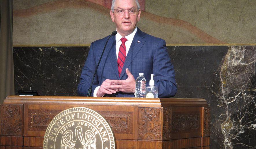 Louisiana Gov. John Bel Edwards talks about the coronavirus outbreak and state vaccination efforts, Thursday, April 22, 2021, in Baton Rouge, La. (AP Photo/Melinda Deslatte)