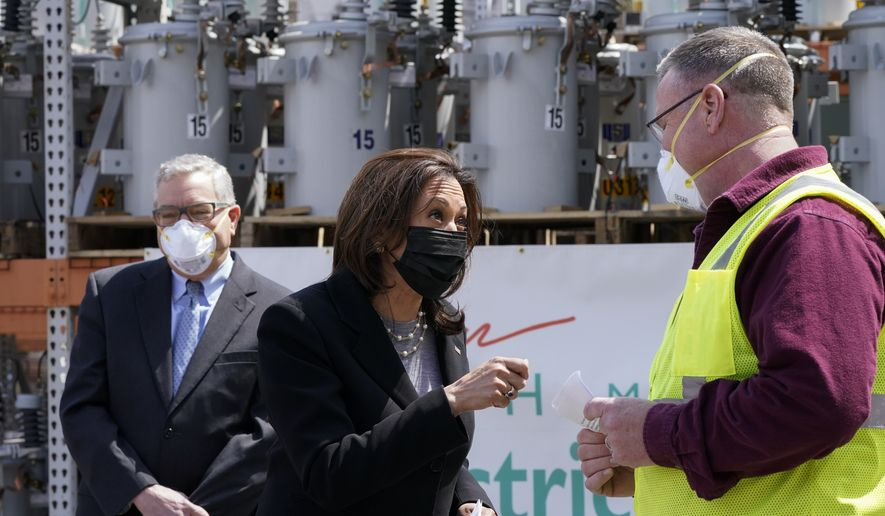 Vice President Kamala Harris speaks with Jeff Bird, IBEW Line Design Technician at NHEC, right, at the New Hampshire Electric Co-Op (NHEC), in Plymouth, N.H., Friday, April 23, 2021. (AP Photo/Jacquelyn Martin)