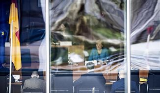 German Chancellor Angela Merkel sits as a witness before the Bundestag's investigative committee on the Wirecard AG accounting scandal in Berlin, Germany, Friday, April 23, 2021. (Michael Kappeler/dpa via AP)