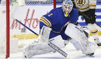 Buffalo Sabres goalie Ukko-Pekka Luukkonen makes a save during the first period of the team's NHL hockey game against the Boston Bruins, Friday, April 23, 2021, in Buffalo, N.Y. (AP Photo/Jeffrey T. Barnes)