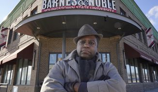 Andre Brady poses for a photo outside the Barnes & Noble, Thursday, Jan. 21, 2021, in Youngstown, Ohio. On its surface, the story of Brady's fight to keep his well-paying union job at a public university bookstore that was privatized isn't unique. Hundreds of workers have watched as their positions at once-independent college bookstores disappeared in recent years as operations were transferred to national book retailing giants. What makes the Ohio man's case notable is that it created a five-year paper trail that provides rare detail on the handover of the store from Youngstown State University to Barnes & Noble.  (AP Photo/Tony Dejak)