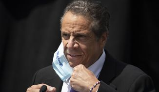 """FILE - In this June 15, 2020, file photo, New York Gov. Andrew Cuomo removes a mask as he holds a news conference in Tarrytown, N.Y. Cuomo's office said it won't reveal what it told the U.S. Justice Department about COVID-19 outbreaks in nursing homes, partly because doing so would be an """"invasion of personal privacy."""" (AP Photo/Mark Lennihan, File)"""