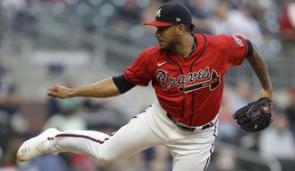 Atlanta Braves pitcher Huascar Ynoa works against the Arizona Diamondbacks during the first inning of a baseball game Friday, April 23, 2021, in Atlanta. (AP Photo/Ben Margot)