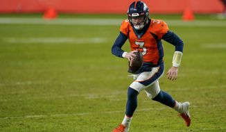 """FILE - In this Jan. 3, 2021, file photo, Denver Broncos quarterback Drew Lock scrambles against the Las Vegas Raiders during an NFL football game in Denver. """"We're really high on Drew. I like seeing Drew here every morning and when I come in he's working hard, he's trending in the right direction. As you know, he has a lot of talent. He's becoming a better pro,"""" general manager George Paton said at his pre-draft news conference. """"But we're still going to look at the quarterback position."""" (AP Photo/Jack Dempsey, File)"""