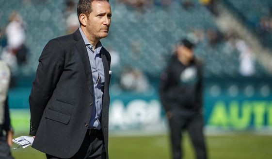 FILE - In this Nov. 3, 2019, file photo, Philadelphia Eagles general manager Howie Roseman stands on the field before the team's NFL football game against the Chicago Bears in Philadelphia. The Eagles have drafted so poorly over the past seven years that fans go to baseball games and chant for Roseman to be fired. (AP Photo/Chris Szagola, File)