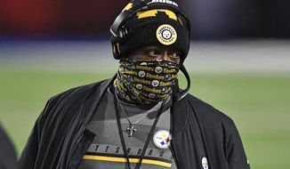 FILE - Pittsburgh Steelers head coach Mike Tomlin walks on the sideline during the first half of an NFL football game against the Buffalo Bills in Orchard Park, N.Y., in this Sunday, Dec. 13, 2020, file photo. The Steelers have the 24th overall pick in the draft and could use it to find a replacement for longtime Pro Bowl center Maurkice Pouncey, who retired during the offseason.(AP Photo/Adrian Kraus, File)