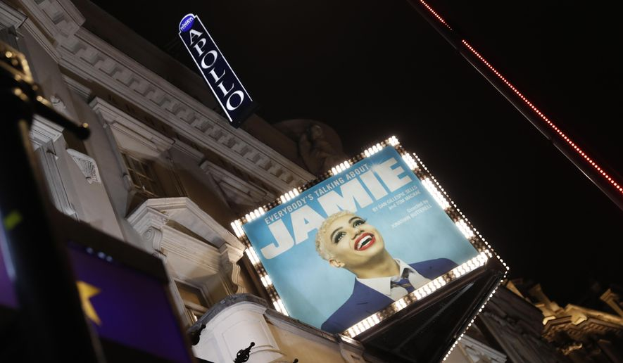 """A general view of the exterior of the Apollo Theater, which is preparing to continue its run of the musical """"Everybody's Talking About Jamie' in London, Thursday, April 8, 2021. The coronavirus pandemic has devastated British theater, a world-renowned cultural export and major economic force. The theaters in London's West End shut when lockdown began in March 2020, and have remained closed for most of the past 13 months. Now they are preparing, with hope and apprehension, to welcome audiences back. (AP Photo/Alastair Grant)"""