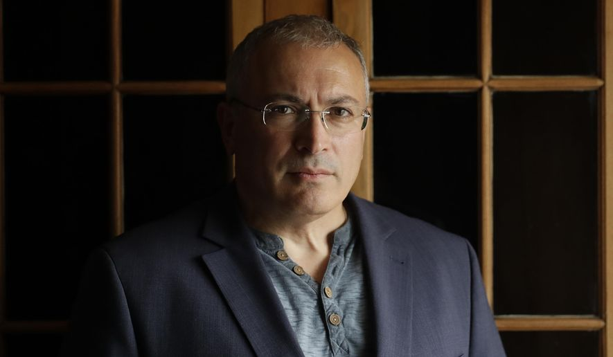 FILE - In this Tuesday, July 24, 2018 file photo, Russian opposition figure Mikhail Khodorkovsky, the former owner of the Yukos Oil Company, poses for a photograph after being interviewed by The Associated Press in London. A key legal advisor to the Dutch Supreme Court on Friday April 23, 2021, recommended dismissing Russia's appeal against a lower court's decision to reinstate a $50 billion compensation award to former shareholders of the Yukos oil company. (AP Photo/Matt Dunham, File)