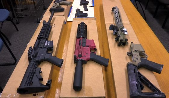 """FILE - In this Nov. 27, 2019, file photo, are """"ghost guns"""" on display at the headquarters of the San Francisco Police Department in San Francisco. A gun control bill proposed by a Nevada lawmaker who survived a 2017 mass shooting in Las Vegas has sparked opposition from both Second Amendment activists and police reform advocates. The state Assembly on Tuesday, April 20, 2021, passed a proposal by Assemblywoman Sandra Jauregui to ban build-your-own """"ghost guns."""" (AP Photo/Haven Daley, File)"""