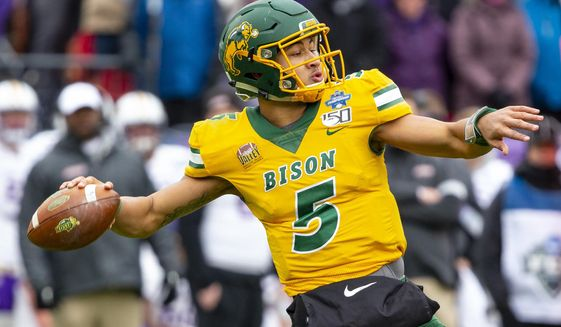 FILE - In this  Saturday, Jan. 11, 2020 file photo, North Dakota State quarterback Trey Lance (5) winds up to throw during the first half of the FCS championship NCAA college football game against James Madison in Frisco, Texas. The NFL announced last month that some of the top prospects were being invited to Cleveland. The league is hoping to incorporate some of the city's best-known locations along Lake Erie: FirstEnergy Stadium, home of the Browns; and the Rock & Roll Hall of Fame.  (AP Photo/Sam Hodde, File)