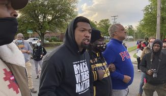 In this image taken from video, Quentin Jackson, regional director for the National Black Caucus of Local Elected Officials, addresses protesters blocking Business U.S. 17 in Elizabeth City, N.C., on Thursday, April 22, 2021. The crowd was demanding that authorities release body camera footage showing the fatal officer-involved shooting of Andrew Brown Jr. the day before. (AP Photo/Allen G. Breed)