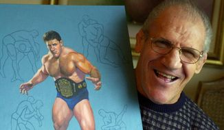 FILE - In this Nov. 30, 2000, file photo, former pro wrestler Bruno Sammartino poses with a painting of him in his Pittsburgh home.   A Pittsburgh suburb on Friday, April 23, 2021 honored Sammartino by renaming a park in the longtime resident's honor. Sangree Park in Ross Township will be known as Sammartino Park, after the man who lived in the community for more than 50 years. (AP Photo/Gene J. Puskar, File)