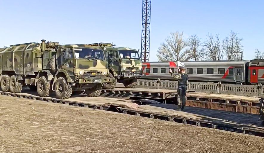 This handout photo taken from a video released on Friday, April 23, 2021 by Russian Defense Ministry Press Service shows, Russian military trucks are readied for loading after drills in Crimea. Russian Defense Minister Sergei Shoigu on Thursday ordered troops back to their permanent bases after a massive military buildup that caused Ukrainian and Western concerns. (Russian Defense Ministry Press Service via AP) **FILE**