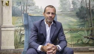 FILE - In this file photo dated Sunday, Aug. 23, 2020, UEFA President Aleksander Ceferin poses for a picture during an interview with The Associated Press in Lisbon, Portugal.  Ceferin said Friday April 23, 2021, that the Spanish and Italian clubs still clinging to the Super League must disavow the breakaway or face being banned from the Champions League. (AP Photo/Manu Fernandez, FILE)