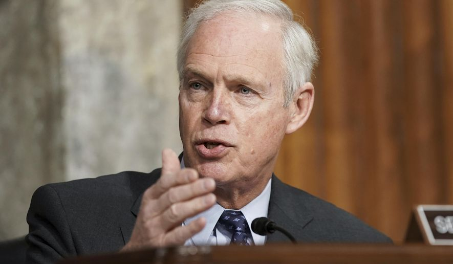 """In this March 3, 2021, file photo, Sen. Ron Johnson, R-Wis., speaks at the U.S. Capitol in Washington.  Johnson, questioned the need for widespread COVID-19 vaccinations, saying in a radio interview """"what do you care if your neighbor has one or not?"""" Johnson,who has no medical expertise or background,made the comments Thursday, April 22, during an interview with conservative talk radio host Vicki McKenna. (Greg Nash/Pool via AP) ** FILE **"""